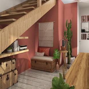 ボルドーの小さいトロピカルスタイルのおしゃれなLDK (ライブラリー、赤い壁、コンクリートの床、暖炉なし、テレビなし、グレーの床) の写真