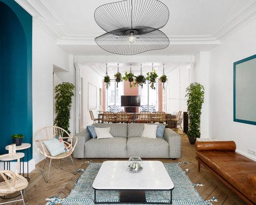 Salon scandinave avec un mur bleu : Photos et idées déco de salons