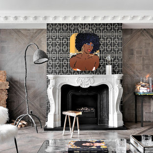 Design ideas for an eclectic open plan living room in London with brown walls, dark hardwood flooring, a standard fireplace and a stone fireplace surround.