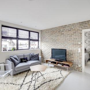 Esempio di un soggiorno industriale di medie dimensioni e aperto con angolo bar, pareti bianche, pavimento in legno verniciato, TV autoportante e pavimento bianco