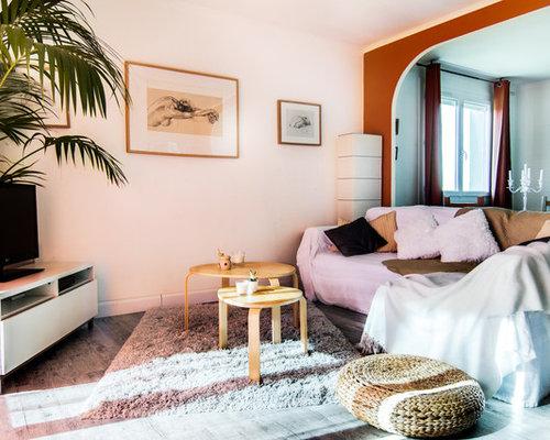 Skandinavische wohnzimmer mit oranger wandfarbe ideen for Wandfarbe kamin