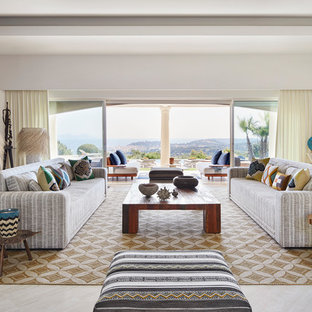 Huge coastal formal and open concept travertine floor and beige floor living room photo with white walls