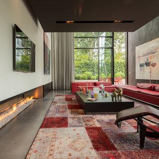 Ispirazione per un soggiorno minimal con pareti bianche, pavimento in cemento, camino lineare Ribbon e TV a parete