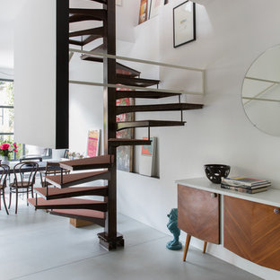 Inspiration For A Mid Sized Industrial Metal Spiral Metal Railing Staircase  Remodel In Milan