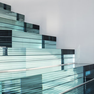 Trendy glass staircase photo in Milan with glass risers