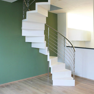 Example of a mid-sized trendy painted spiral metal railing staircase design in Bologna with painted risers