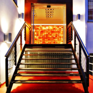Staircase - large contemporary painted straight staircase idea in Milan