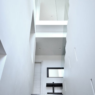 Staircase - contemporary marble u-shaped staircase idea in Other with marble risers