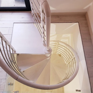 Staircase - small modern painted spiral open and mixed material railing staircase idea in Milan