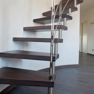 Inspiration for a large contemporary painted spiral staircase remodel in Milan with painted risers