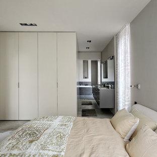 Idee per una grande camera matrimoniale contemporanea con pareti grigie, pavimento in cemento, nessun camino e pavimento grigio