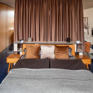 Diseño de dormitorio tipo loft, actual, grande, con paredes blancas y suelo azul