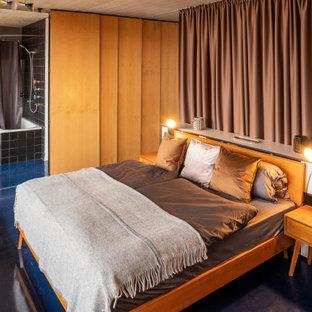 Imagen de dormitorio tipo loft, urbano, grande, con paredes blancas y suelo azul