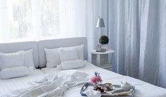 Ein weißes Schlafzimmer, romantisch und doch mit unendlich viel Stauraum
