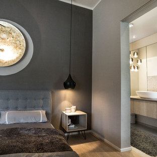 Elegant Design Ideas For A Small Urban Master Bedroom In Munich With Grey Walls And  Light Hardwood