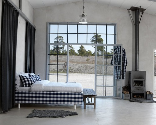 11 Bedroom With A Wood Stove And Concrete Floors Design