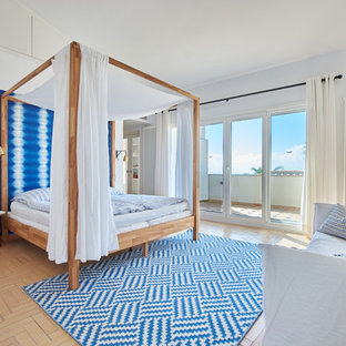 Inspiration for a beach style bedroom in Palma de Mallorca with white walls, terra-cotta floors and beige floor.