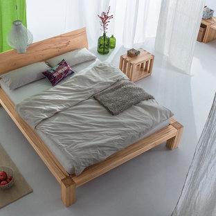 Design ideas for a large asian loft-style bedroom in Bremen with white walls, linoleum floors and grey floor.