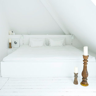 Design ideas for a small modern master bedroom in Hamburg with white walls, painted wood flooring and white floors.