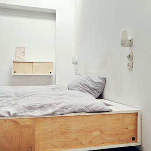 Example Of A Minimalist Master Bedroom Design In Hamburg With White Walls