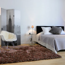 Contemporary Bedroom by WELLHAUSEN Immobilien Styling