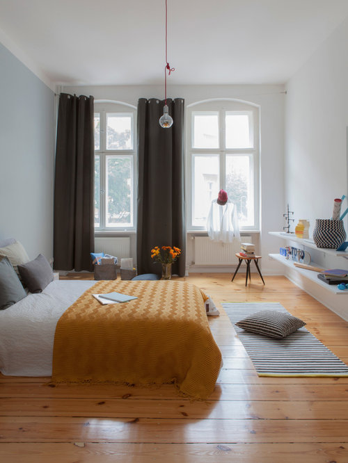 Inspiration For A Large Scandinavian Master Medium Tone Wood Floor And  Brown Floor Bedroom Remodel In