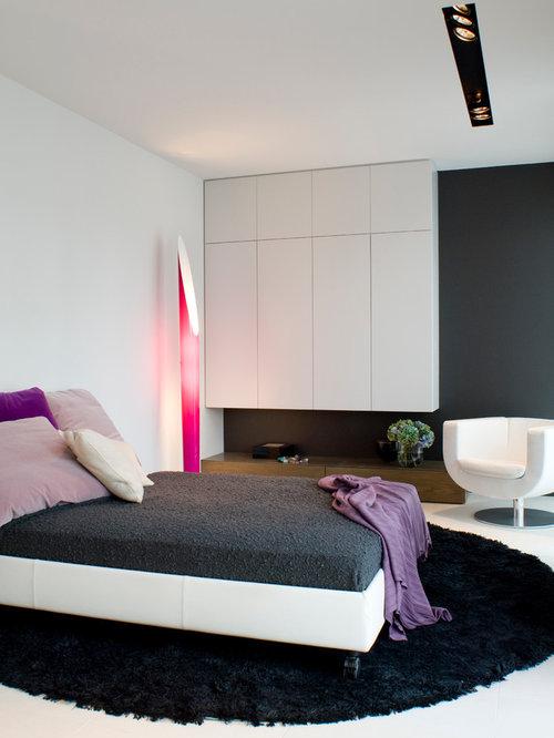 Mittelgroßes Modernes Schlafzimmer Ohne Kamin Mit Schwarzer Wandfarbe In  Frankfurt Am Main