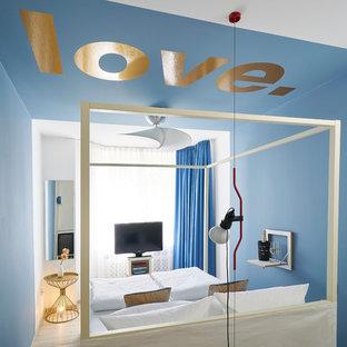 Bedroom - small eclectic guest vinyl floor and beige floor bedroom idea in Nuremberg with blue walls