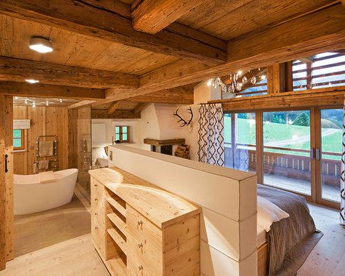 rustikale schlafzimmer mit verputztem kaminsims ideen design bilder houzz. Black Bedroom Furniture Sets. Home Design Ideas