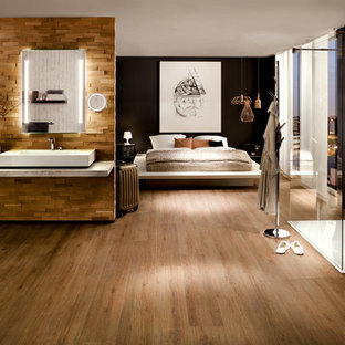 Design ideas for a bedroom in Cologne with brown walls, vinyl floors and brown floor.