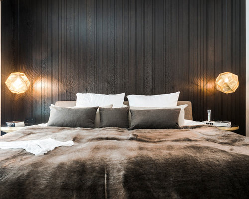 Inspiration for a modern bedroom remodel in munich with black walls