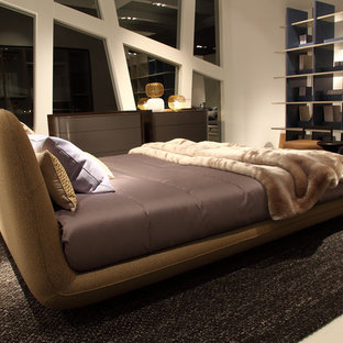 Inspiration for a large timeless master limestone floor and beige floor bedroom remodel in Munich with beige walls