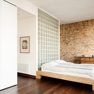 Inspiration for a mid-sized contemporary bedroom in Berlin with brown walls, dark hardwood floors and no fireplace.