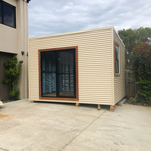 This is an example of a small contemporary detached studio in Gold Coast - Tweed.