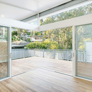 Inspiration for a mid-sized beach style detached granny flat in Sydney.