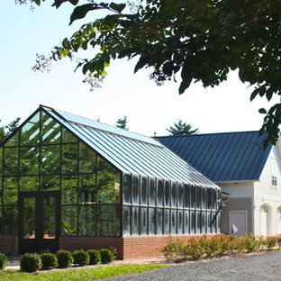 Inspiration for an expansive traditional detached greenhouse in Other.