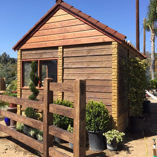 This is an example of a medium sized classic detached garden shed in Dallas.