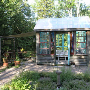 Example of a mountain style detached studio / workshop shed design in Burlington