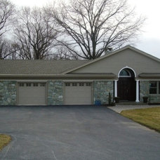 Traditional Garage And Shed by Eppinette Construction LLC