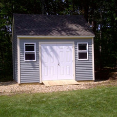 Traditional Garage And Shed by Okerman Construction and Remodeling