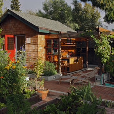 Rustic Garage And Shed by Sogno Design Group