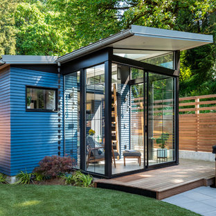 Example of a small trendy detached guesthouse design in Seattle