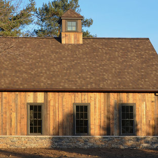 Inspiration for a large farmhouse detached barn remodel in New York