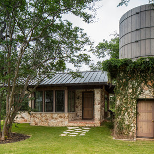 Example of a country detached guesthouse design in Austin