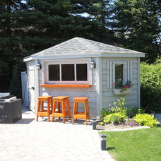 Traditional Garage And Shed by The Pool Craft Company