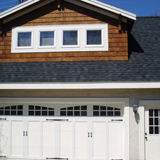 Traditional Garage And Shed by Sharper Homes, Inc