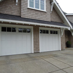 Coachman Garage Doors - Clopay Coachman door, model CD13 with Rec13 glass.  Installed by Harbour Door, Victoria, BC