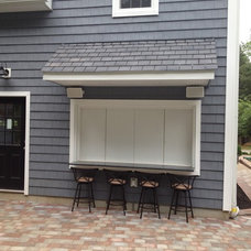 Traditional Garage And Shed by Premier Remodels