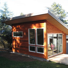 Contemporary Garage And Shed by Conscious Construction Inc.