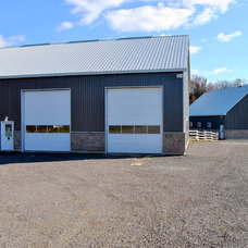 Traditional Garage And Shed by Bricon Contracting